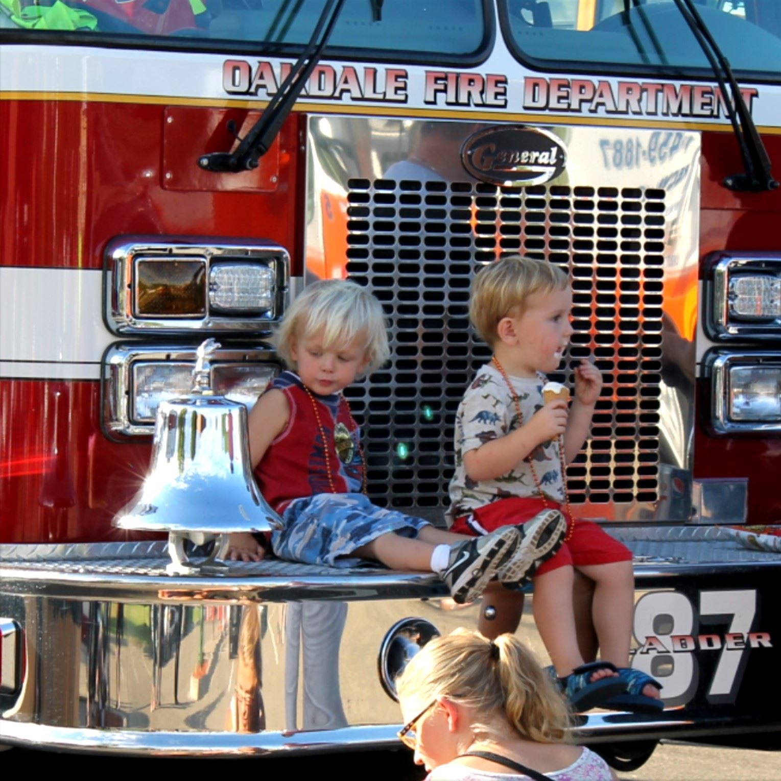 Kids eating ice cream on a firetruck