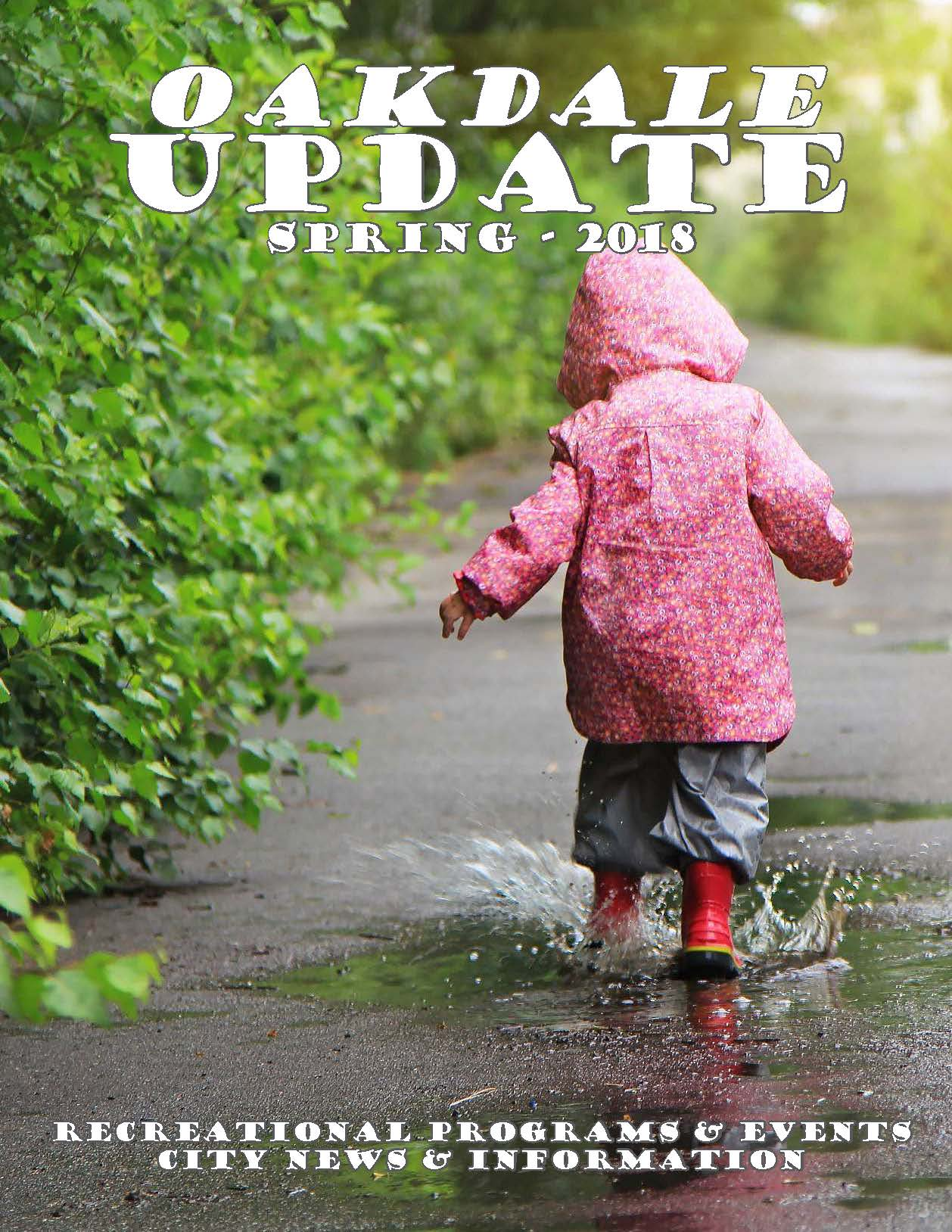 Cover of Oakdale Update Newsletter for Spring 2018 showing child in pink raincoat in puddle