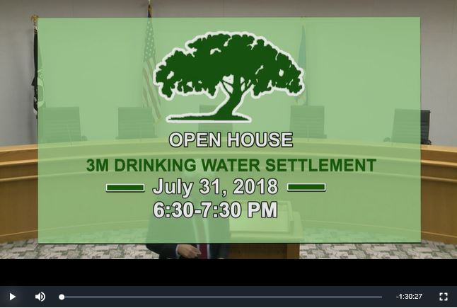 Image of television screen with words Open House 3M Drinking Water Settlement