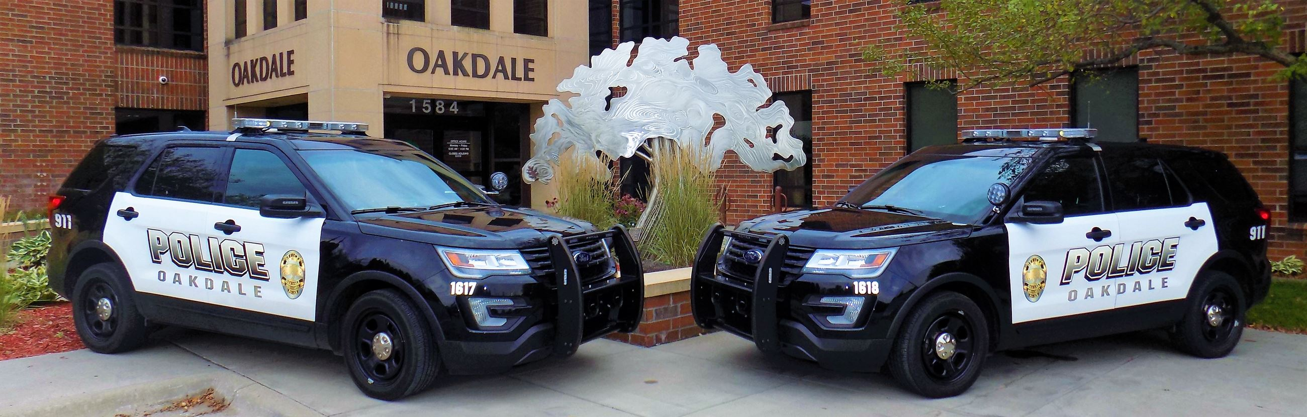 Oakdale police cars in front of city hall